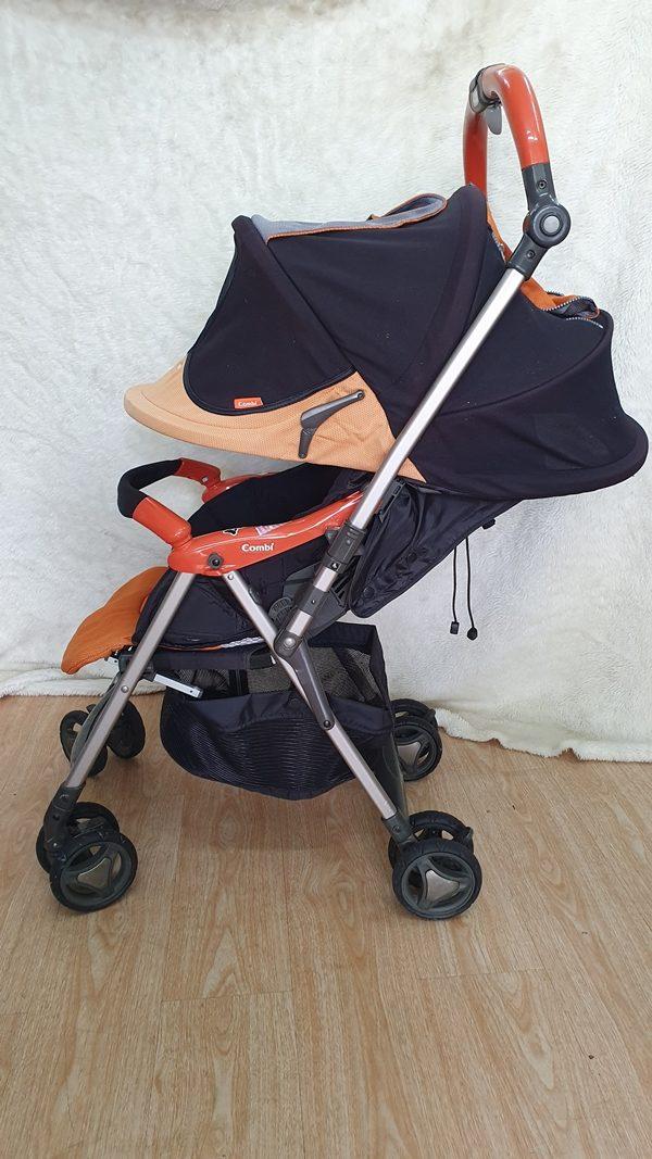 Xe đẩy trẻ em Ricco cam thanh lý 1